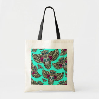 Owl holding sugar skull on mint green base. tote bag