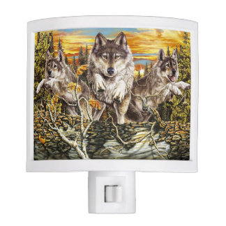 Pack of wolves running nite lights