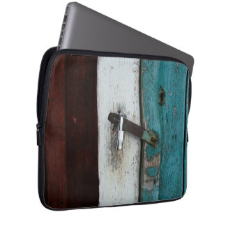 Padlock on old door laptop sleeve