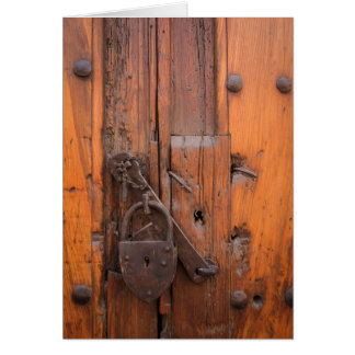 Padlock on wooden door card