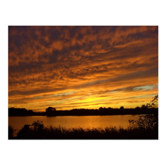 Paint it orange -cloudy lake sunset postcard
