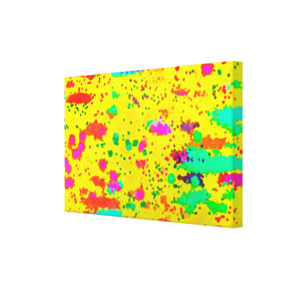Paint splashes on a yellow background canvas print