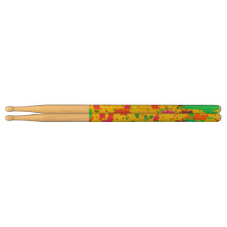 Paint splashes on a yellow background drumsticks