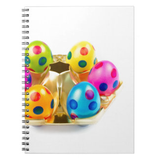 Painted easter eggs in gold tray isolated on white notebooks