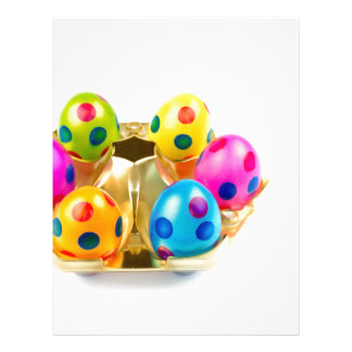 Painted easter eggs in gold tray isolated on white personalized letterhead