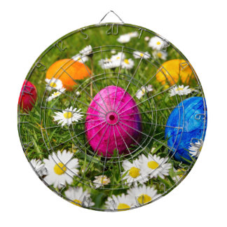 Painted easter eggs in grass with daisies dartboard