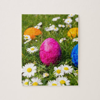 Painted easter eggs in grass with daisies jigsaw puzzle