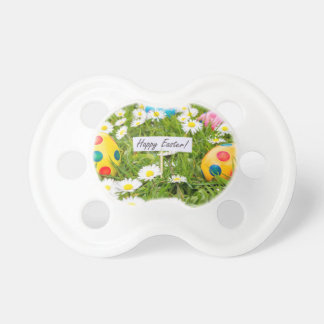 Painted Easter eggs in grass with white daisies Pacifier