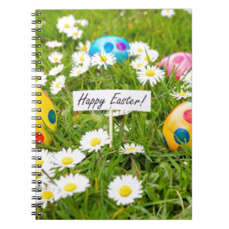 Painted Easter eggs in grass with white daisies Spiral Notebook