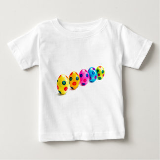 Painted easter eggs in row on white background baby T-Shirt