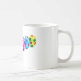 Painted easter eggs in row on white background coffee mug
