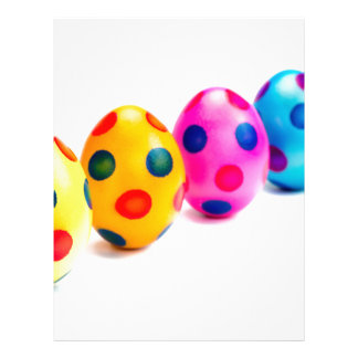 Painted easter eggs in row on white background letterhead