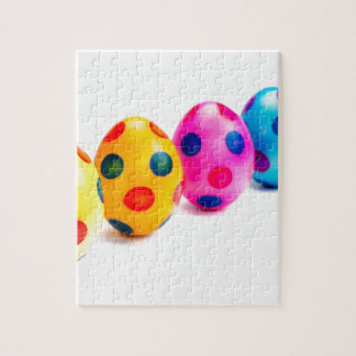 Painted easter eggs in row on white background puzzle