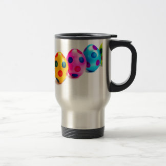 Painted easter eggs in row on white background travel mug