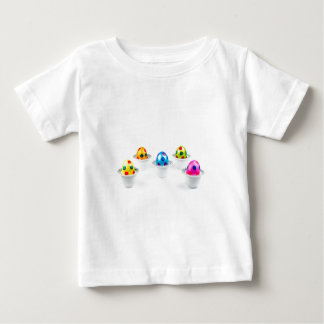 Painted easter eggs standing in porcelain egg cups baby T-Shirt
