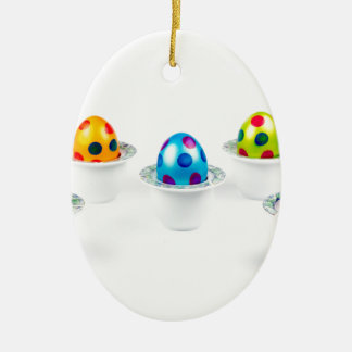 Painted easter eggs standing in porcelain egg cups ceramic ornament