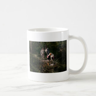 Painted storks in a nest coffee mug