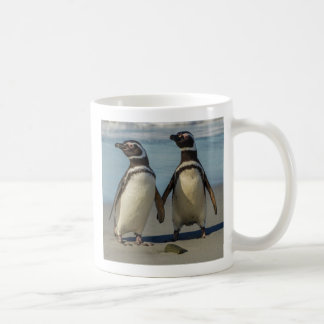 Pair of penguins on the beach coffee mug