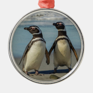 Pair of penguins on the beach Silver-Colored round ornament