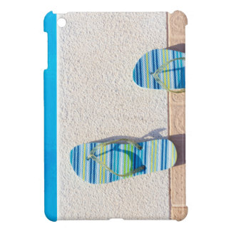 Pair of slippers at edge of swimming pool cover for the iPad mini