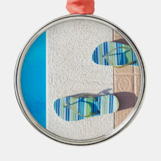 Pair of slippers at edge of swimming pool Silver-Colored round ornament