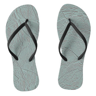 Pale green embossed-effect geometric design flip flops