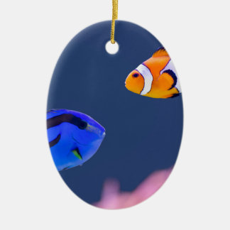 Palette surgeonfish and clown fish swimming ceramic oval ornament