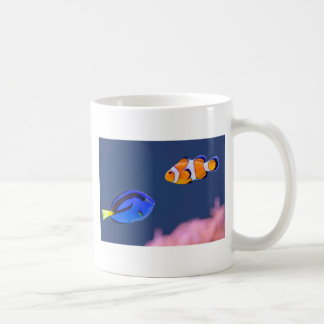 Palette surgeonfish and clown fish swimming coffee mug