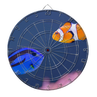 Palette surgeonfish and clown fish swimming dartboards