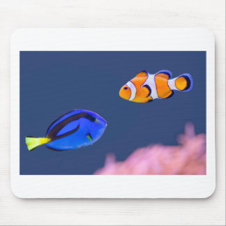 Palette surgeonfish and clown fish swimming mouse pad