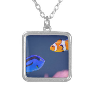 Palette surgeonfish and clown fish swimming silver plated necklace