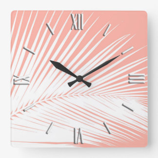 Palm leaf - white on coral pink square wall clock
