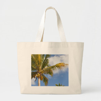 palm trees on the beach large tote bag