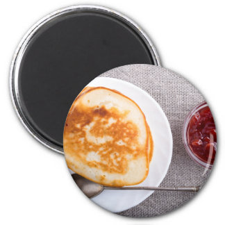 Pancakes and a glass cup with strawberry jam 2 inch round magnet