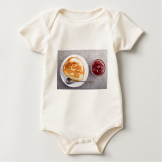 Pancakes and a glass cup with strawberry jam baby bodysuit