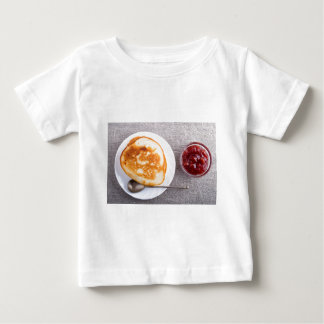 Pancakes and a glass cup with strawberry jam baby T-Shirt
