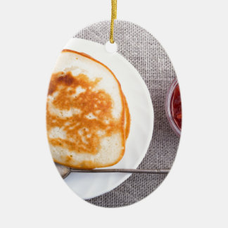 Pancakes and a glass cup with strawberry jam ceramic ornament