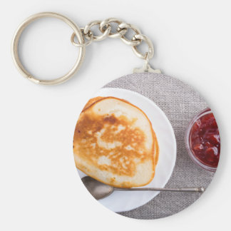 Pancakes and a glass cup with strawberry jam keychain