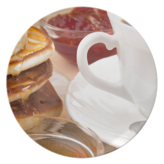Pancakes with honey, strawberry jam dinner plate