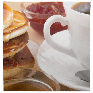 Pancakes with honey, strawberry jam napkin