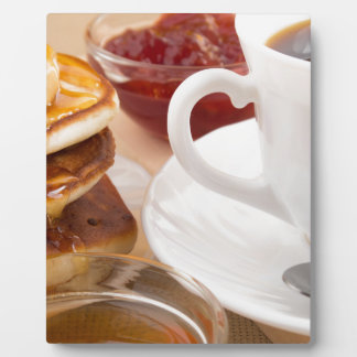 Pancakes with honey, strawberry jam plaque