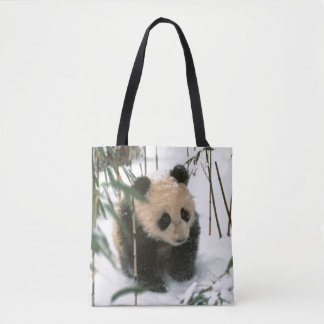 Panda cub on snow, Wolong, Sichuan, China 2 Tote Bag