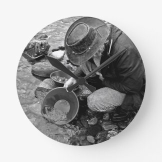 Panning for Gold Black and White Wall Clock