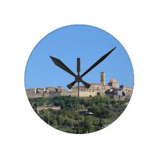 Panorama of Volterra village, province of Pisa Clock