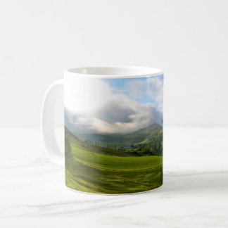 Panoramic mountain meadow vista coffee mug