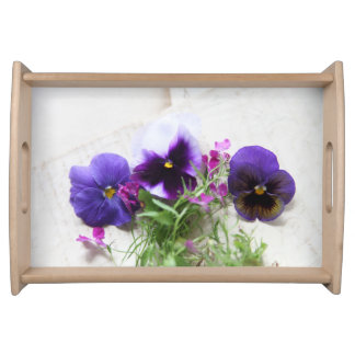 Pansies and lobelia on old handwriting serving tray