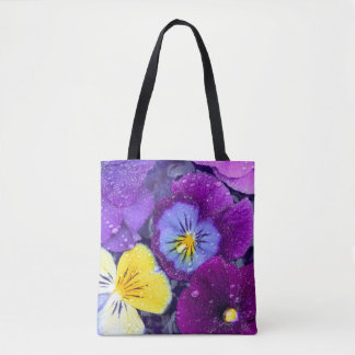 Pansy flowers floating in bird bath with dew tote bag