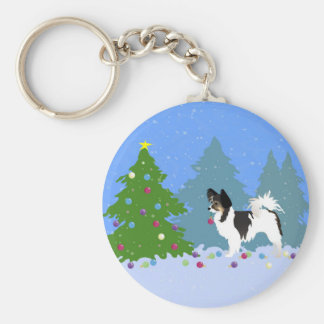 Papillon Dog Decorating Christmas Tree in Forest Keychain