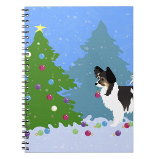 Papillon Dog Decorating Christmas Tree in Forest Notebook