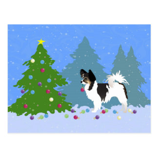 Papillon Dog Decorating Christmas Tree in Forest Postcard